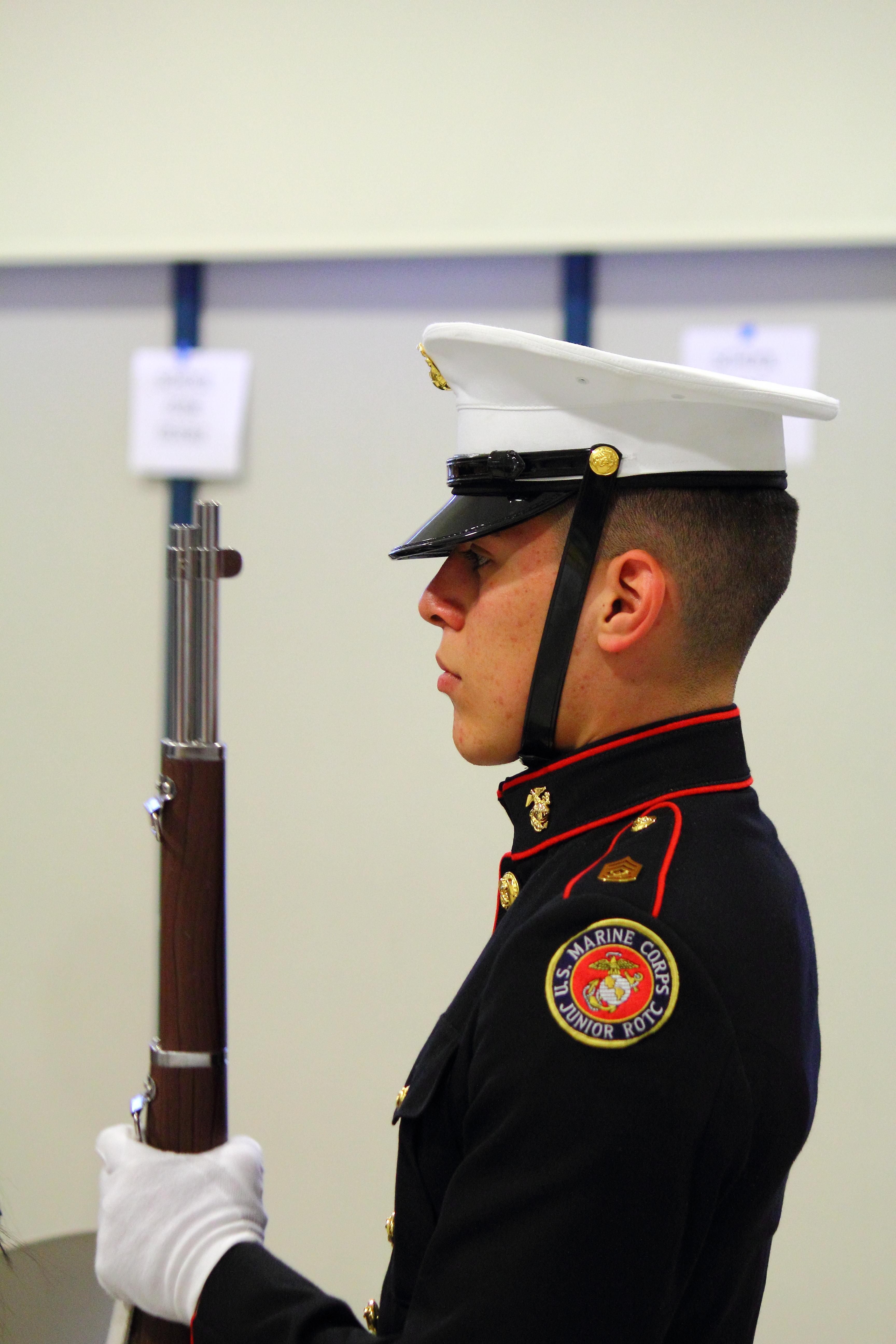 MCJROTC cadet at attention during flag salute