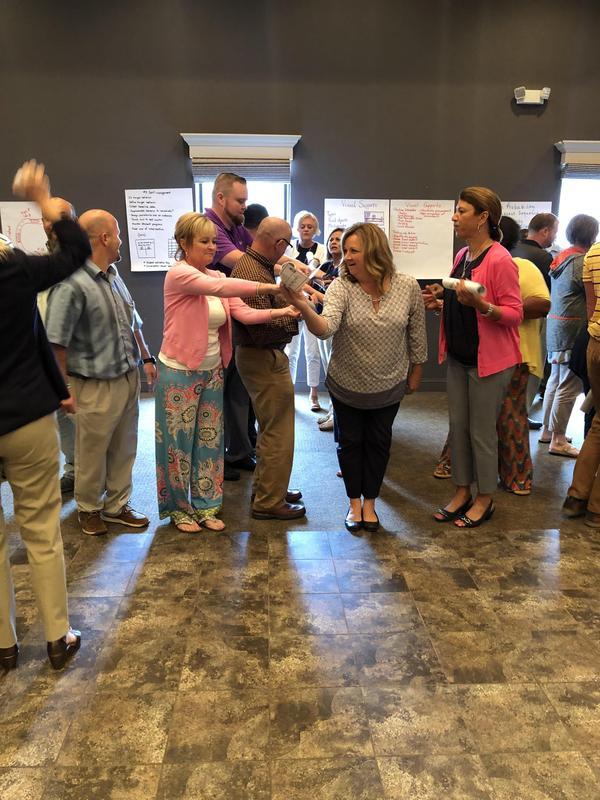 Principals take part in team building activity.