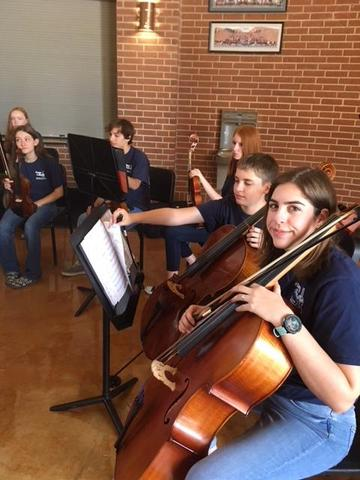 Group of orchestra students with instruments