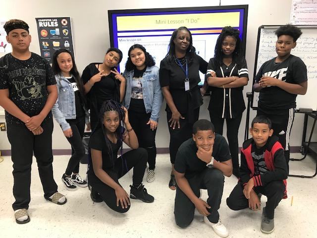 Students and their teacher dressed in black for Blackout Day