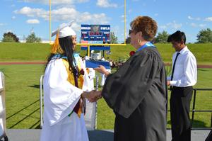 Valedictorian Suhani Patel receives her diploma