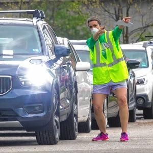 Parents in cars for drive-up service at school