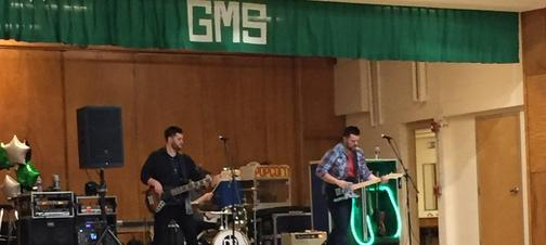 a picture of a band performing
