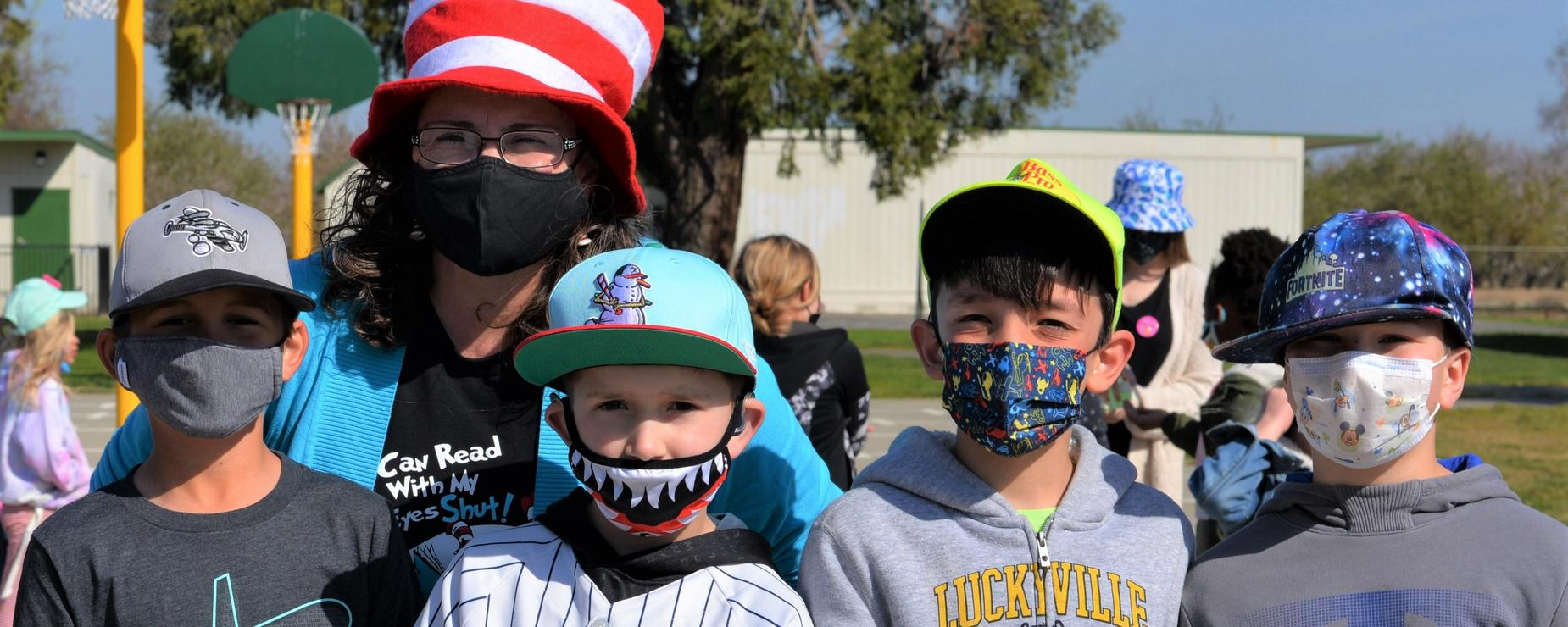 teacher and students dressed up for crazy hat day