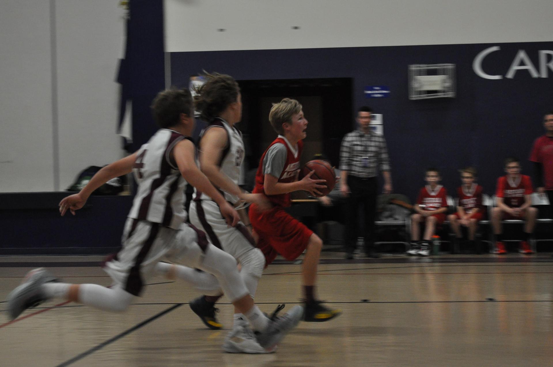 boys basketball driving the lane