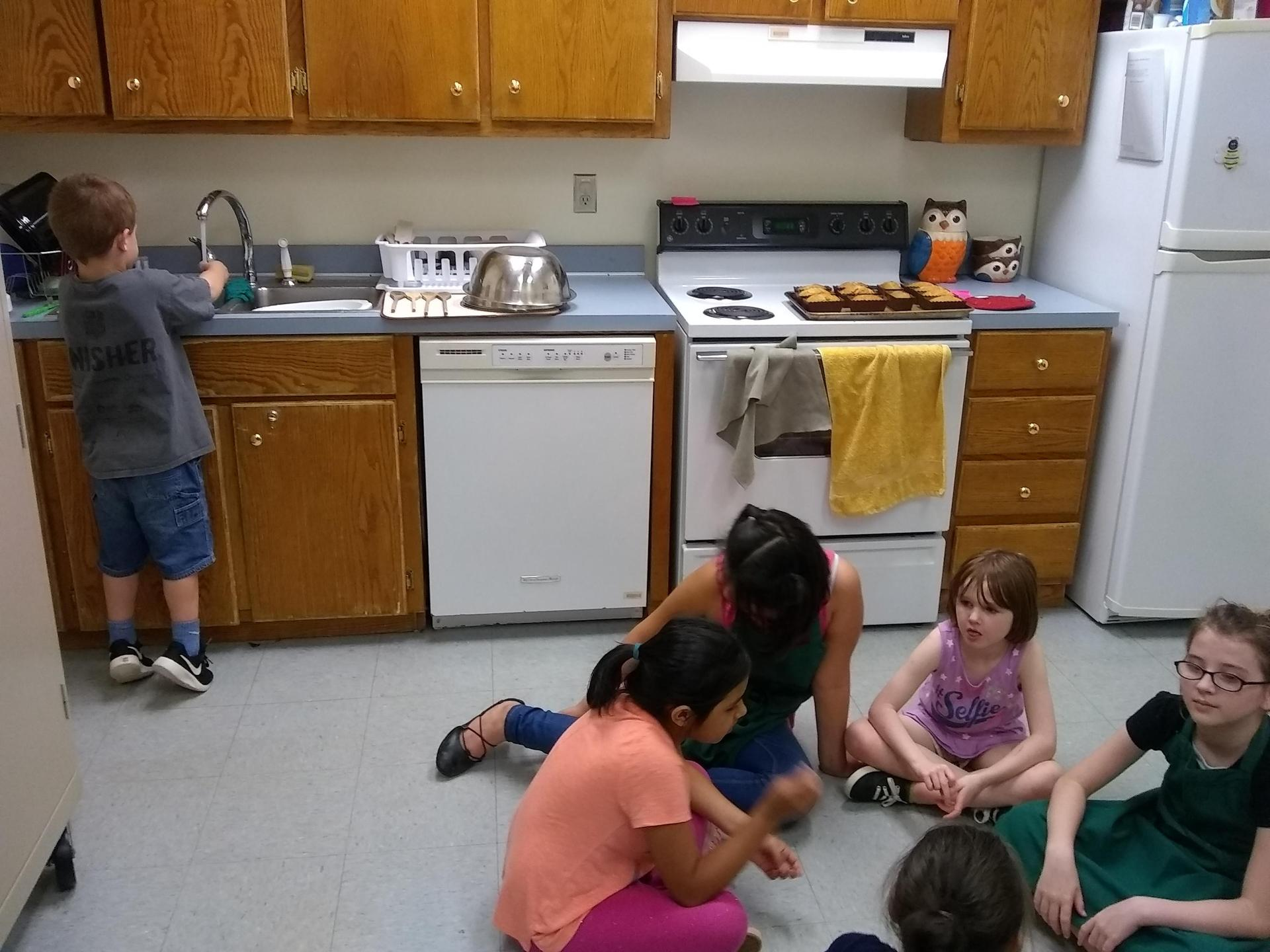 kids waiting in the kitchen patiently