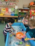 children playing in a water table