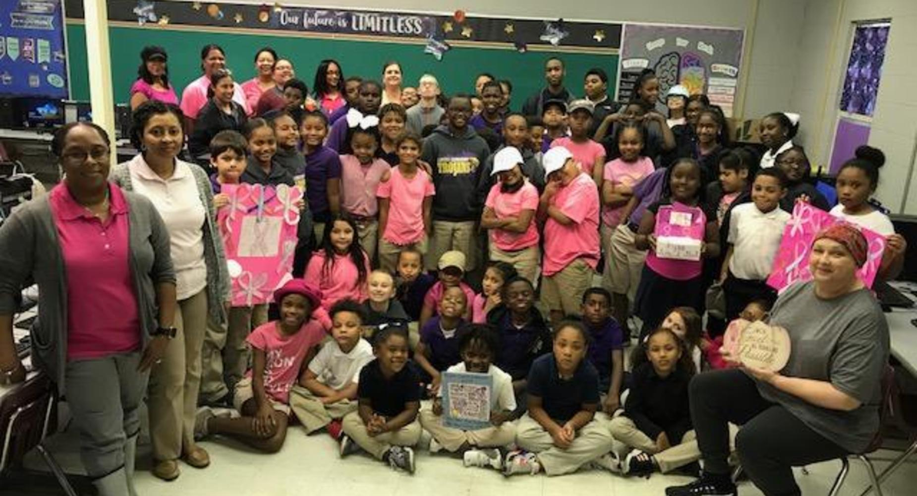 Lawtell Elementary Just One Word, Inc.  21st  Century Community Learning Center Program honored staff member Ms. Sikes for Breast Cancer Awareness Day.  Students and staff members presented gifts and words of encouragement to her as she continues to go through her journey with breast cancer.