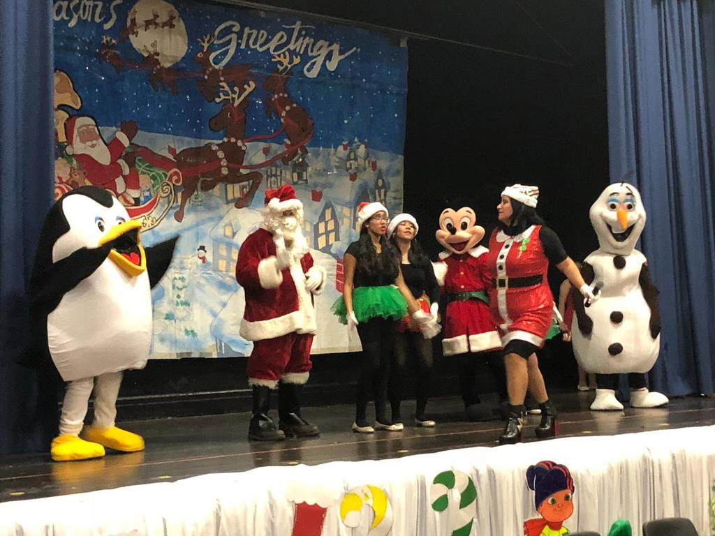 winter characters with children and Santa on Stage