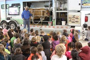 Photo of cow milking demonstration at