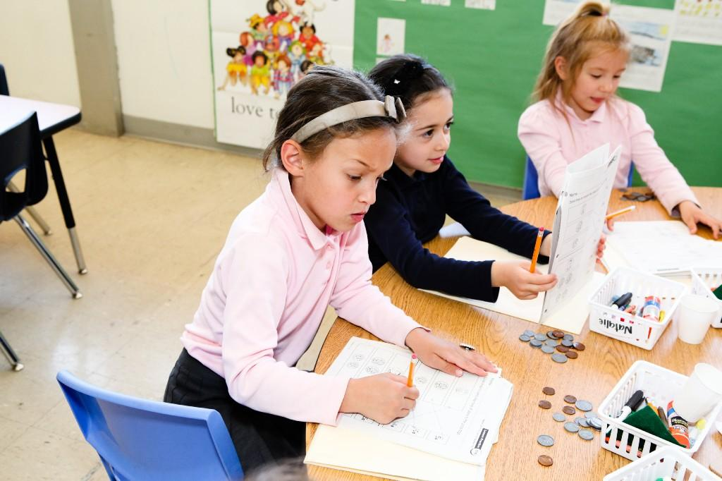 girls learning about coins and money
