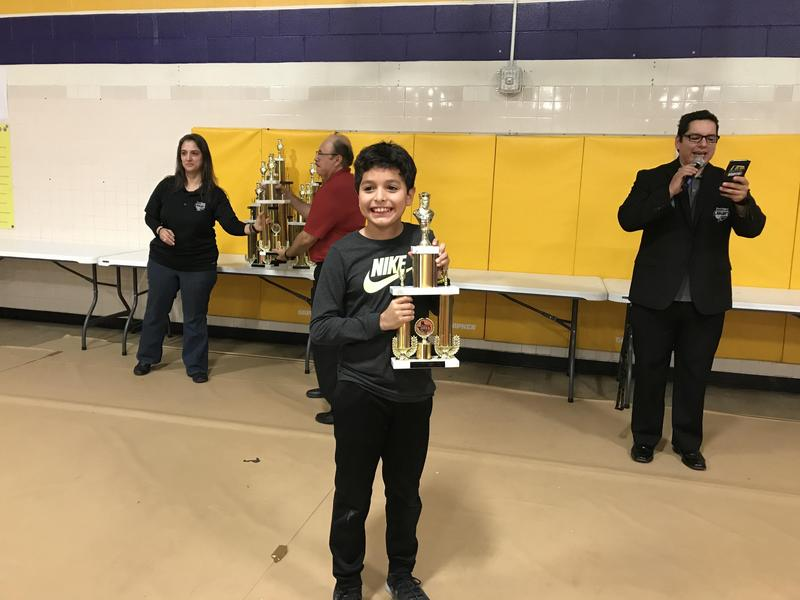 Student holding trophy
