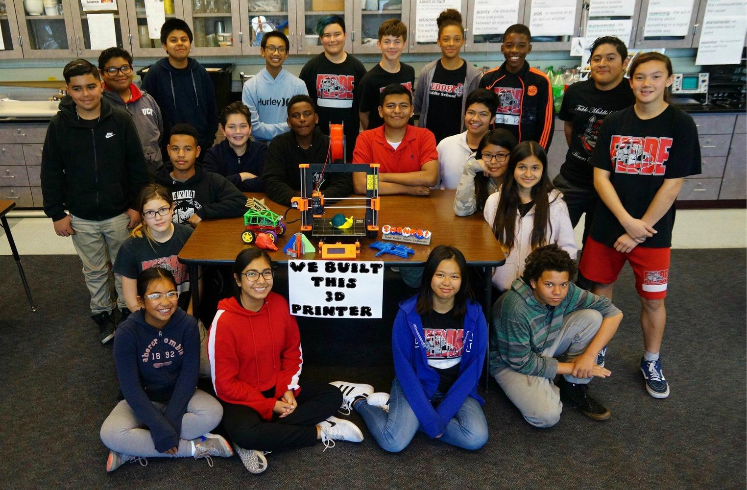 Student photo with 3d printer they built