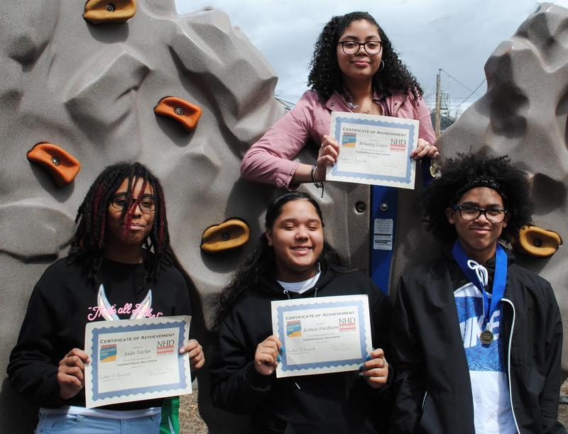 Four middle school students display their awards from Connecticut History Day
