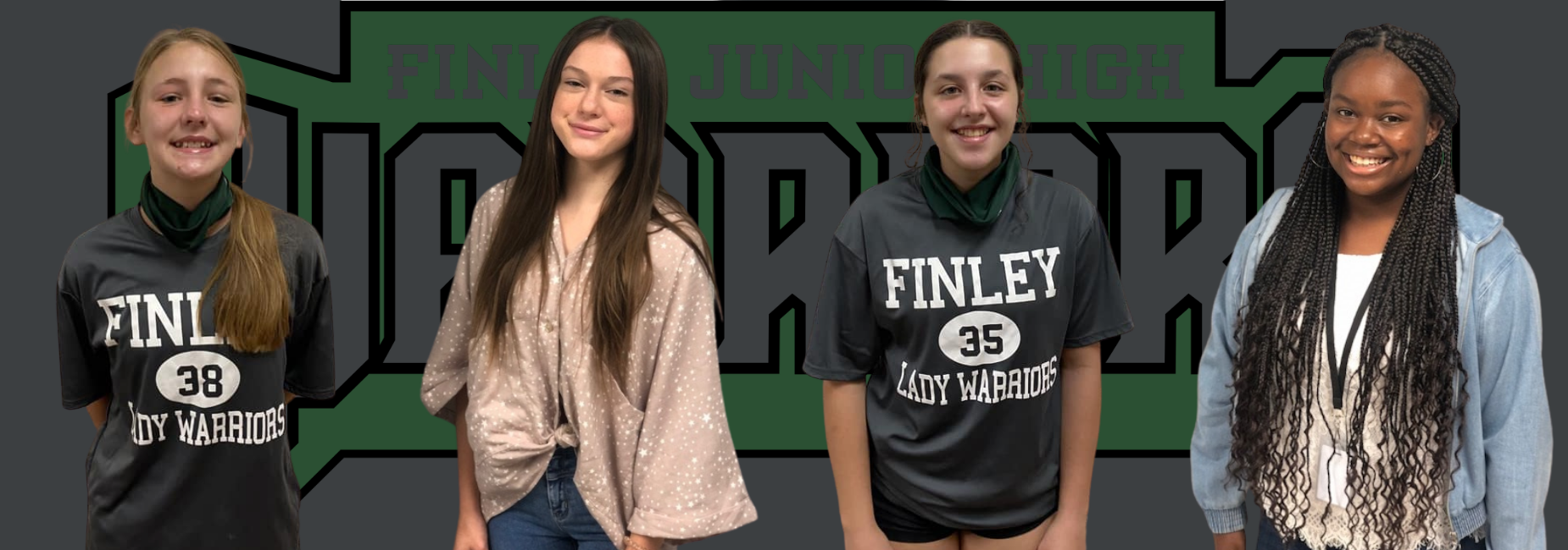 4 girls smiling 2 are in Finley jerseys in front of the Finley Warriors logo