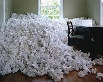 crumpled papers next to a desk