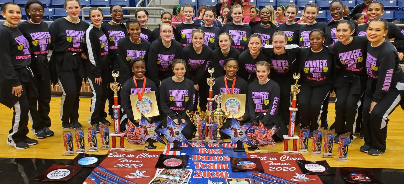 Cherokee Charmers drill team poses with many awards they earned at competition