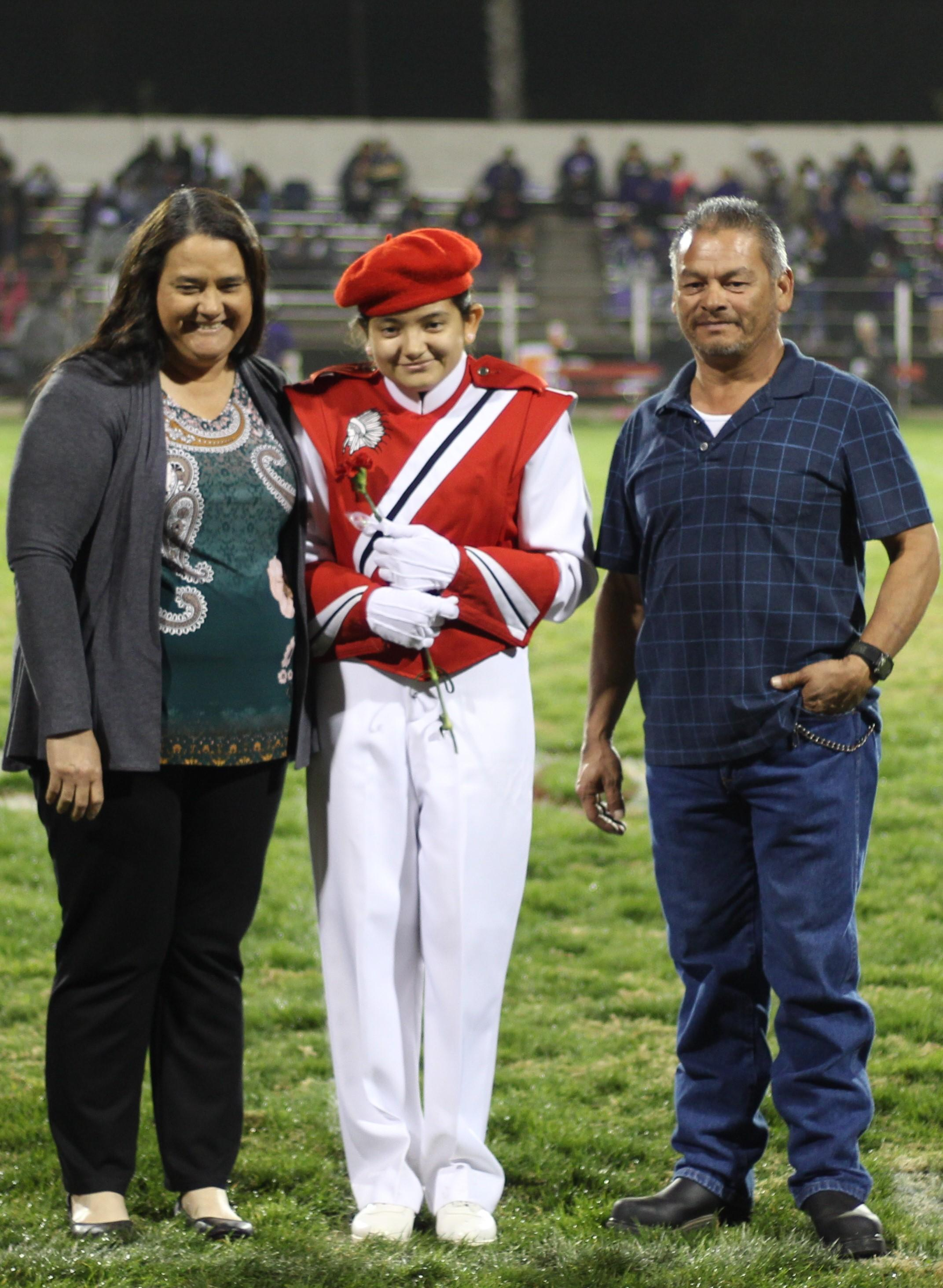 Senior band member Leanna Perales and her escorts.