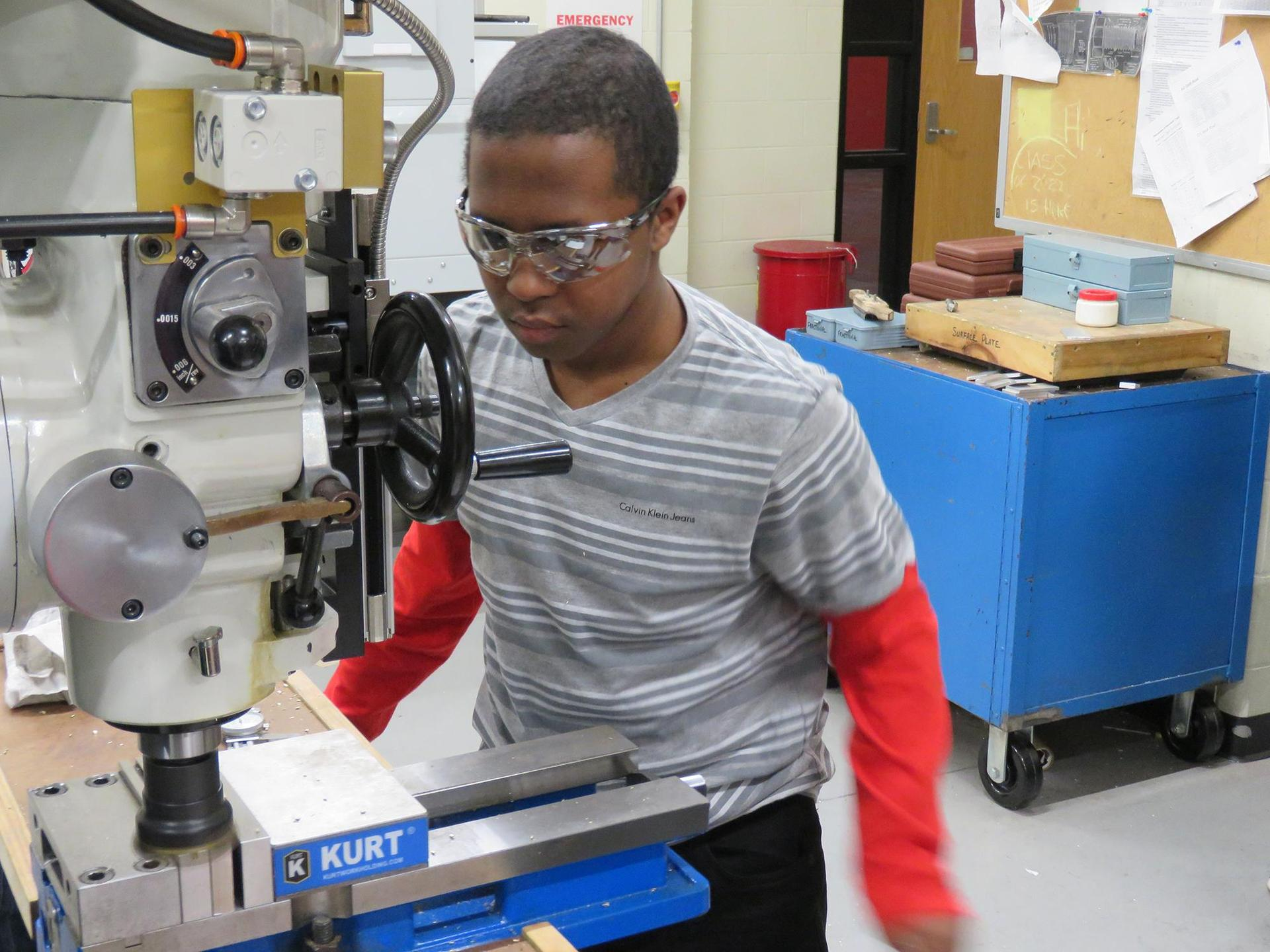 A student works on a project in machine tool technology class