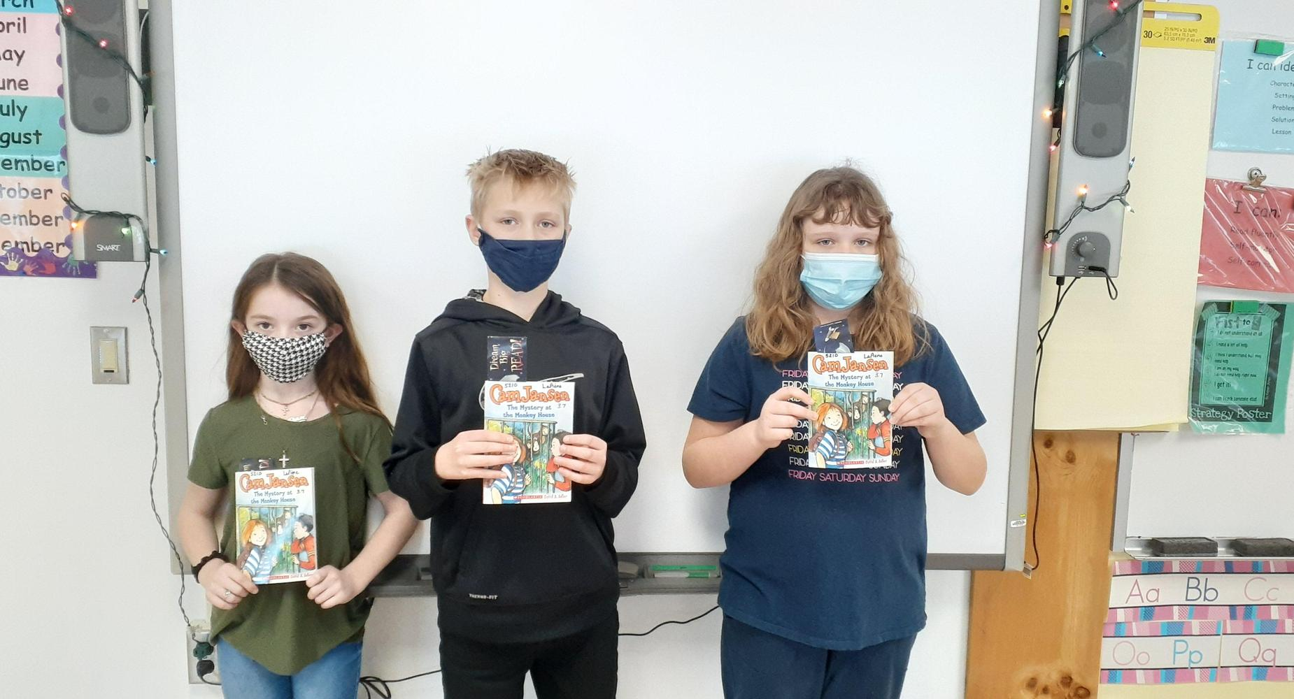 Students holding books.