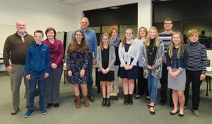 Thornapple Kellogg Board of Education members are pictured with TK Middle School Student Council members who offered them a small token of appreciation for all the board does for the schools.