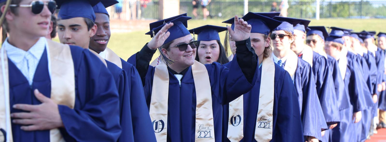 line of graduates smiling