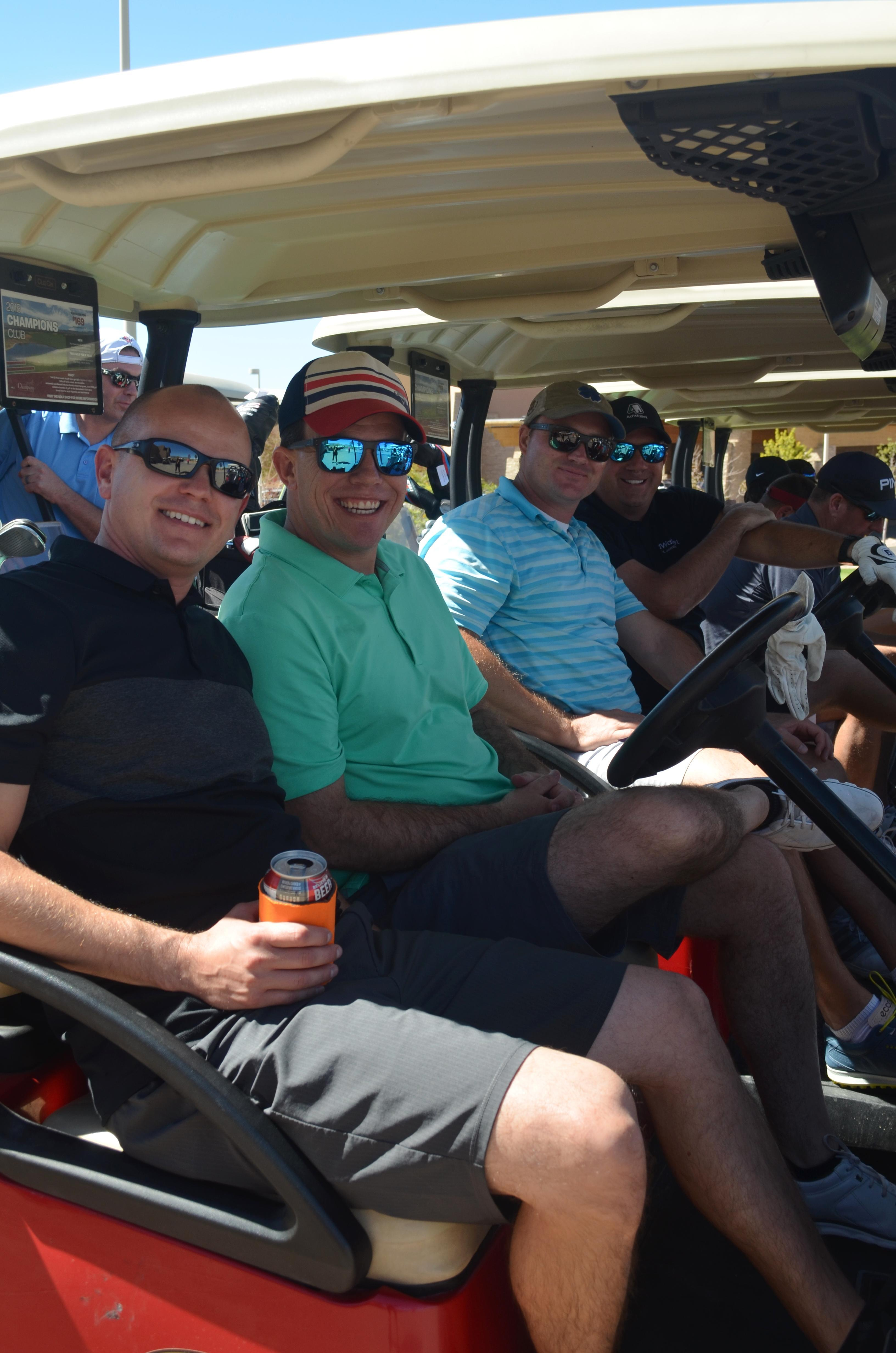 Golfers smile in golf cart
