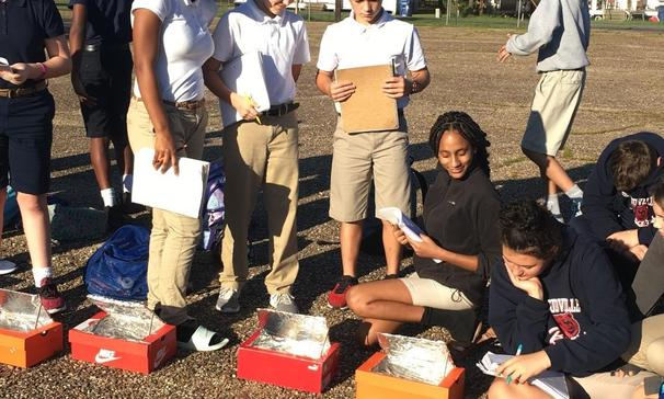 Science class bakes s'mores in the solar ovens