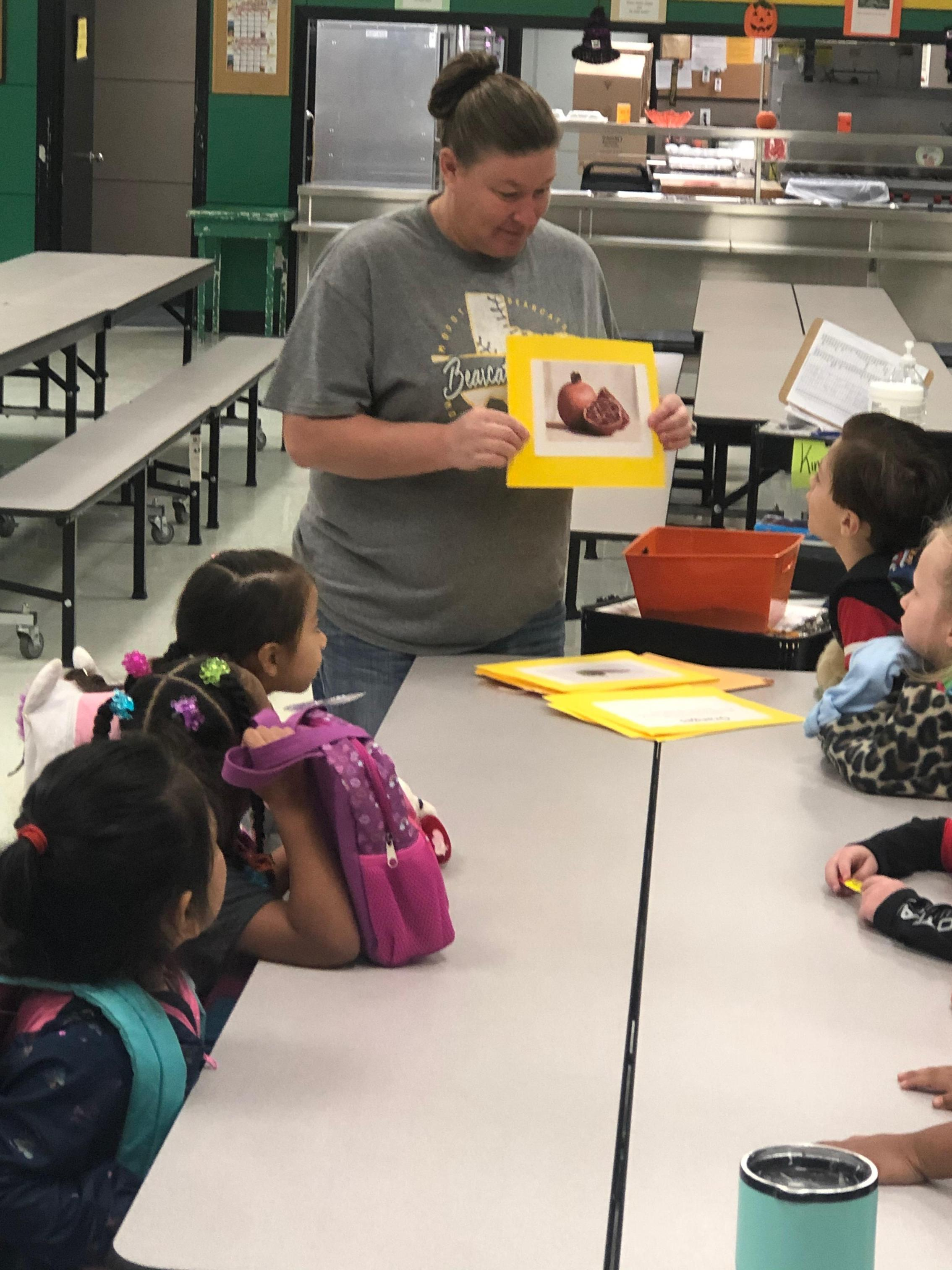 STUDENTS LEARNING ABOUT FRUITS AND VEGETABLES GROWN IN TEXAS