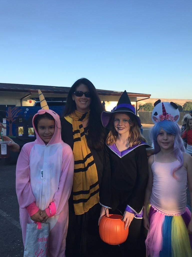 people dressed as unicorn, harry potter and witch