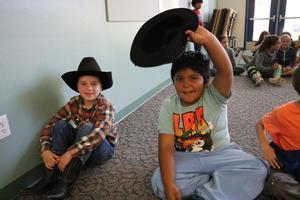 Kids in cowboy hats.