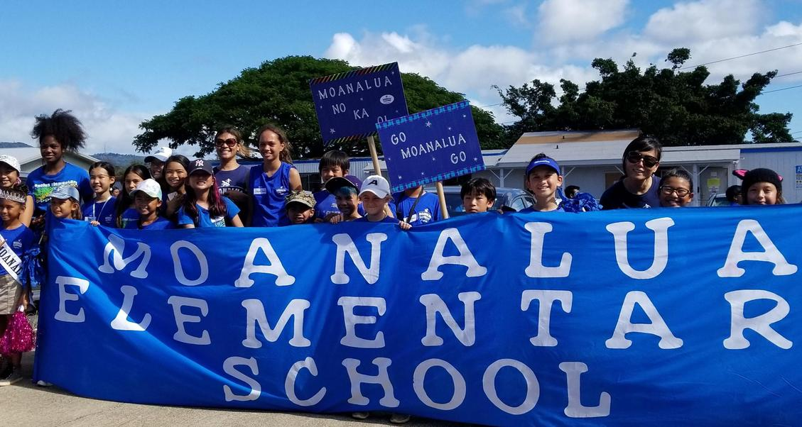 Student council holding Moanalua Elementary School banner