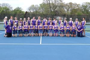 Tennis teams in their purple shirts