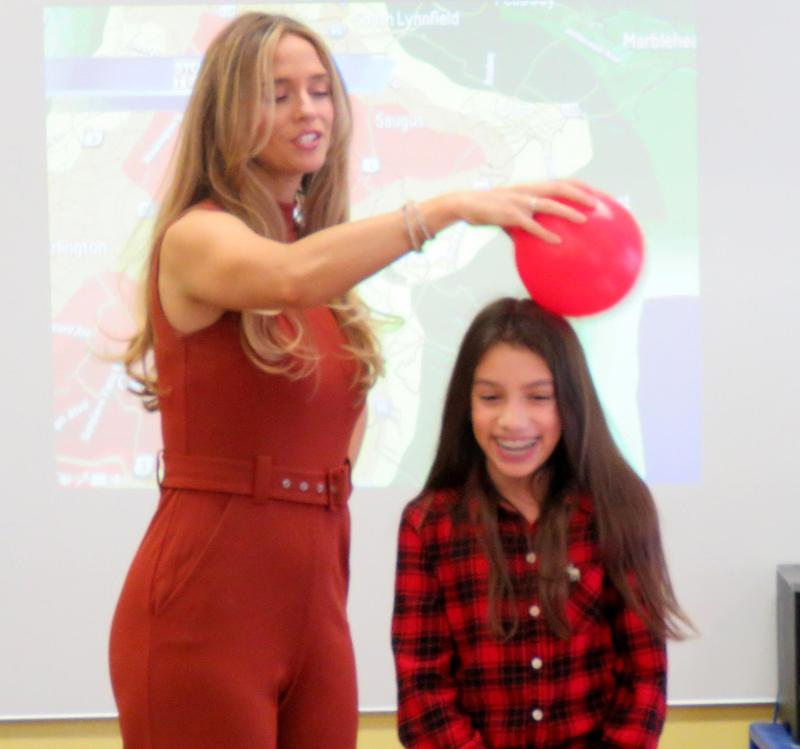 Kelly Ann Cicalese uses a balloon to explain how electricity and lighting work