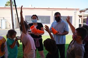 Dr. Guevara helps students get ready for PE