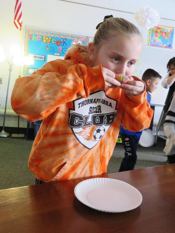 A Lee student takes a taste of Gerber baby food.