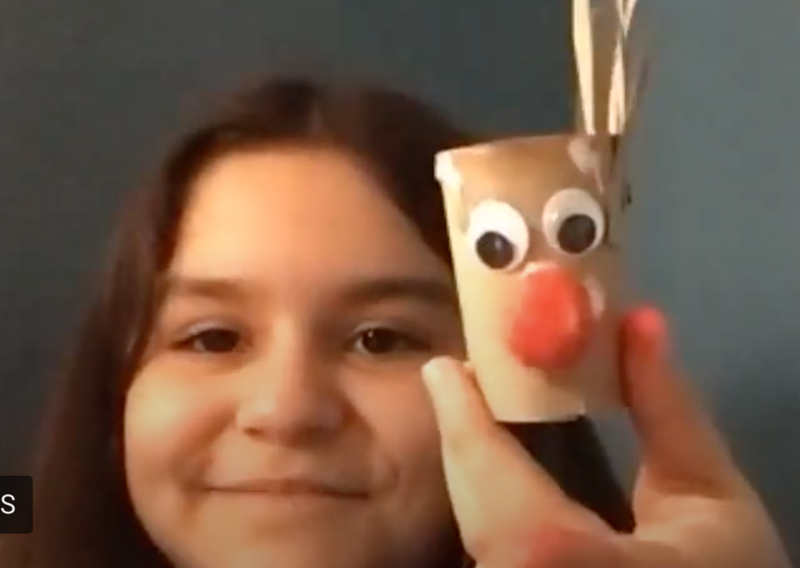 Leslie shows her reindeer art project