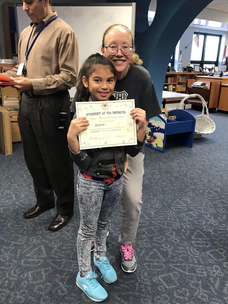 student of the month jeilyn grade 4 with principal O'connel
