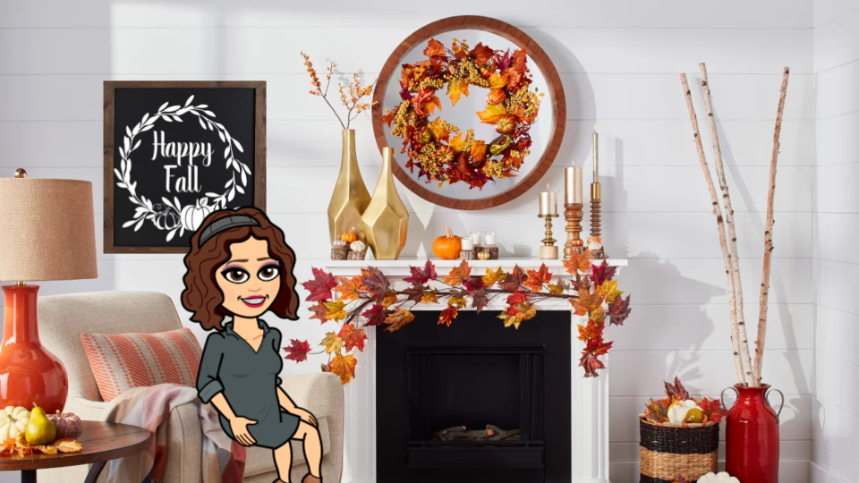 Bitmoji fall scene. Mrs. Greer's bitmoji character is sitting on a chair in front of a decorated mantle.