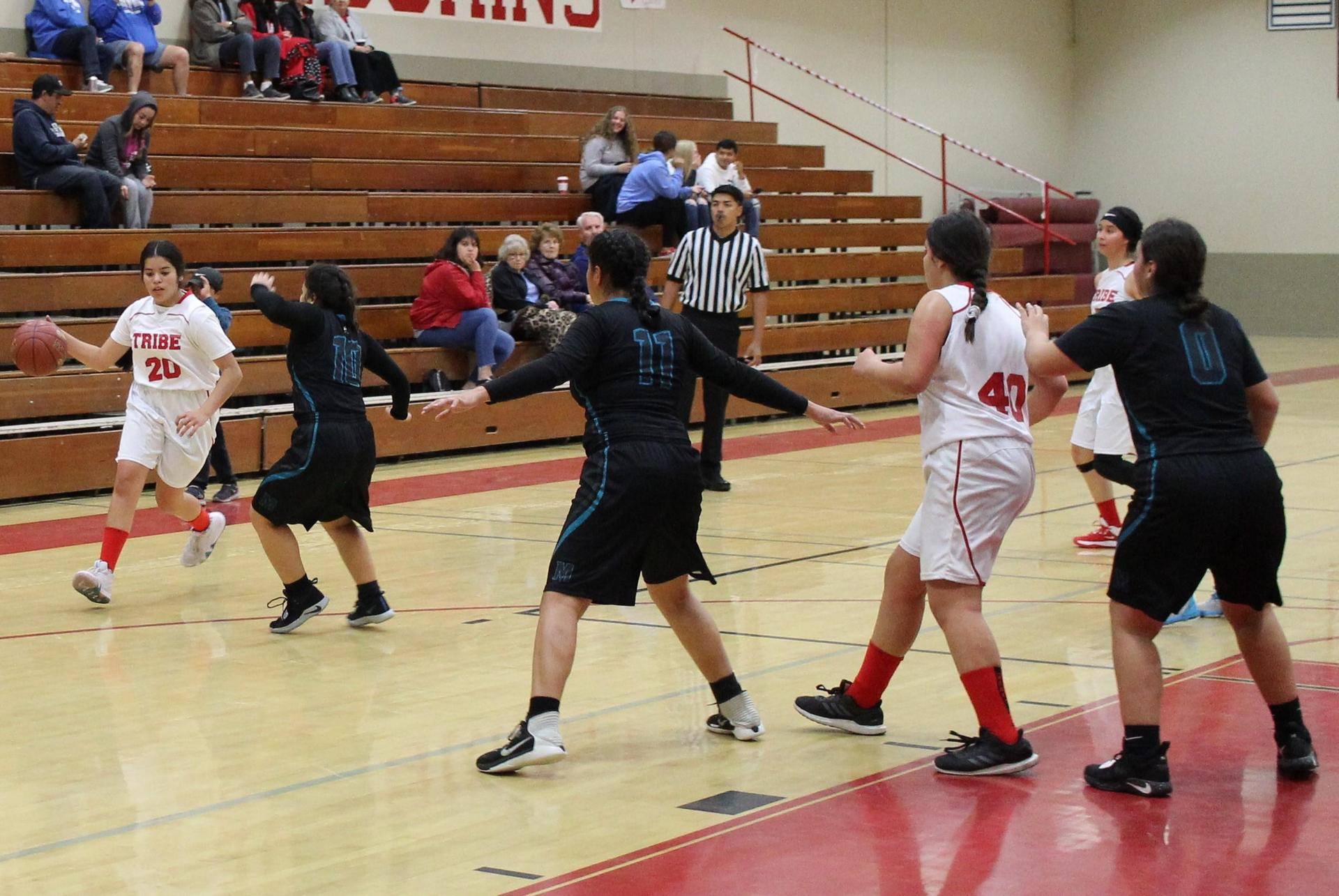 girls playing basketball against Mendota