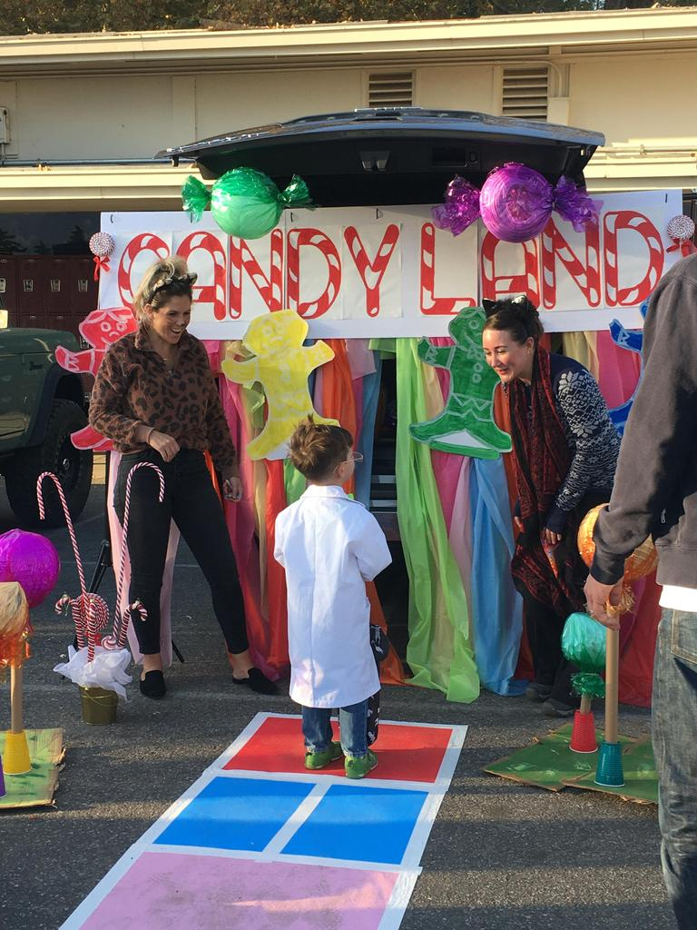 child going to trunk decorated with Candy Land Theme