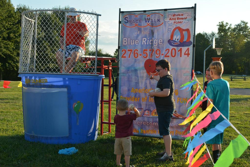 Mr. Kilbourne in the Dunking Booth at Fall Festival