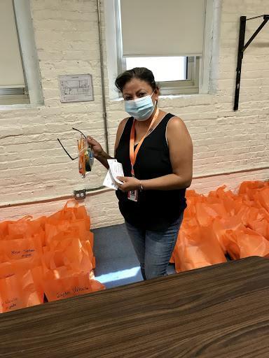 Ms. Duran helping prepare Welcome Packs