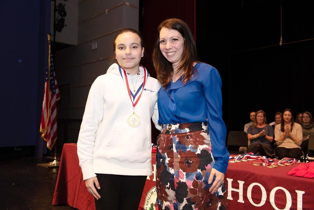 Teacher Katelyn Crossley and a seventh-grade student