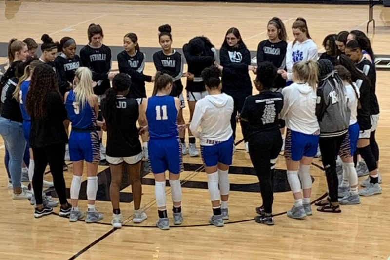 Lady Tigers join hands with Lady Panthers to honor opponents parents killed in a crash
