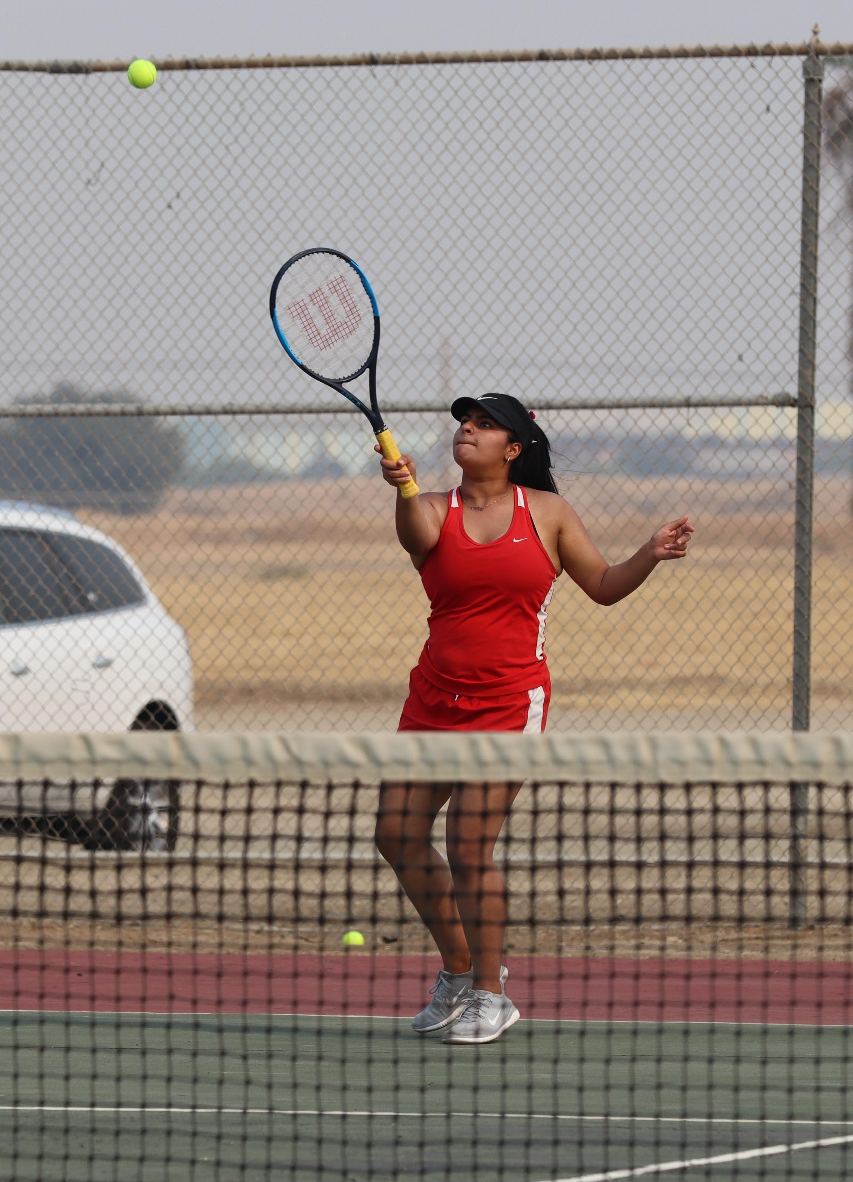 girls playing tennis against firebaugh