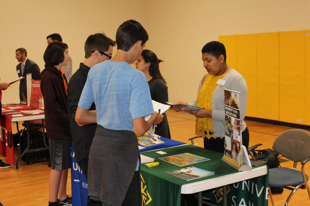 Students meet college reps at the JET college fair.