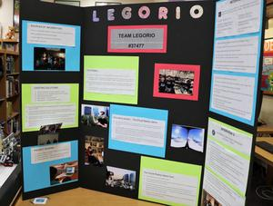 A close up of Team Legorio's tri-fold board showing the research that went into their demonstration at an international robotics competition.
