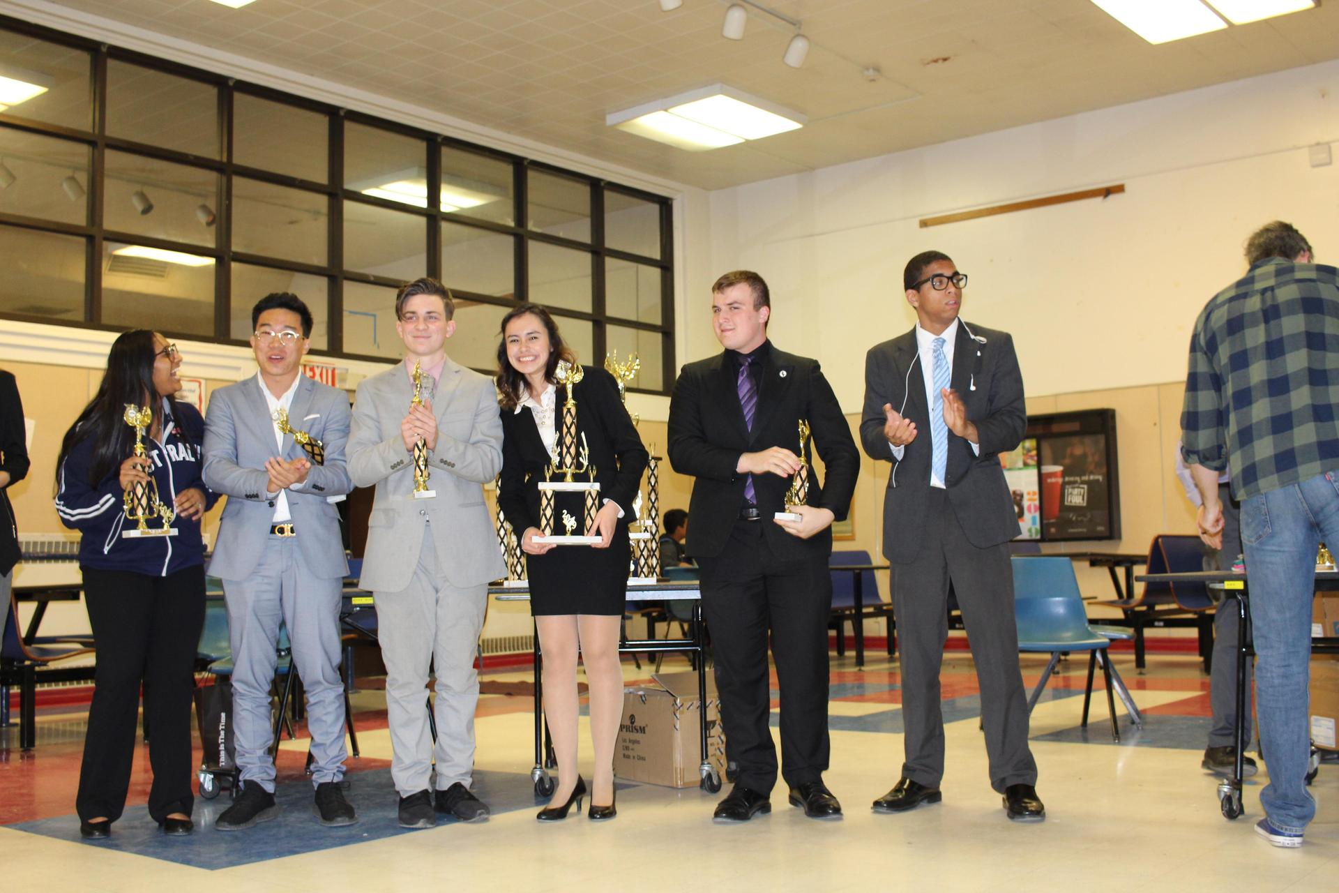 Andrea Jimenez poses with the trophy for winning the Speech and Debate Valley Championship for Original Oratory.