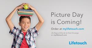 boy holding books and apple on his head
